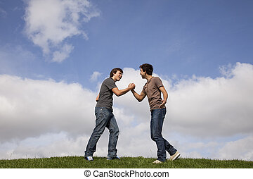 Teenager friendship - two teenager doing a special handshake