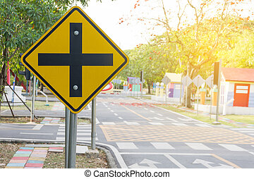 Traffic crossroads. A road sign warns of an intersection...