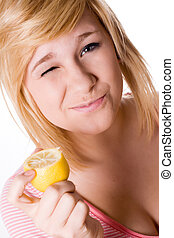young girl holding lemon - beautiful young girl holding a...