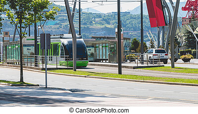 Tramway stops at a station in the city of Bilbao, Spain -...