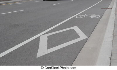 Bicycle lane. - Bicycle lane with passing traffic.