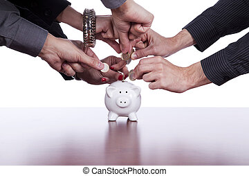 Group of people saving money - Many hands saving money in...