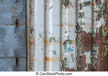 corrugated iron surface is covered with old paint, chipped paint, texture background