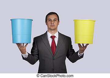 Businessman holding buckets - businessman holding a yellow...