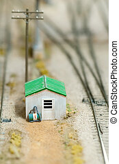 trackside cabin on a miniature train set layout