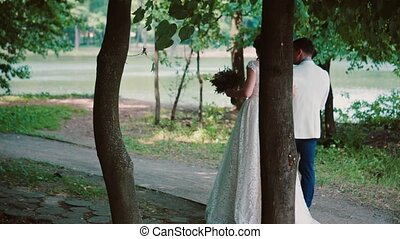 Beautiful couple in love share their wedding day, walking in...
