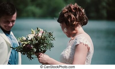 Wedding day. Beautiful couple share happy moment standing on...