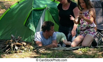 Caucasian dad and son assembling tent on holiday outdoors