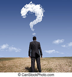 The big question - businessman standing alone at the field...