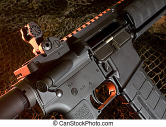 assault rifle - ar15 that is a camouflage netting background...