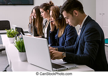 People working with laptop in call center - The workers...