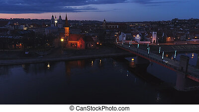 aerial view of old town of city at night -...