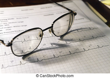 Electrocardiogram Readout and Glasses - A still life of a...