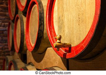 Wine barrels in the antique cellar. Cavernous wine cellar...
