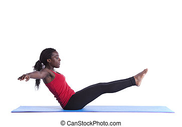 Healthy body balance - young african woman exercising with...