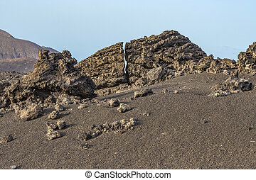 volcano landscape at sunset, national parc of Timanfaya in...