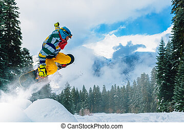snowboarder is jumping very high - snowboarder in red suit...