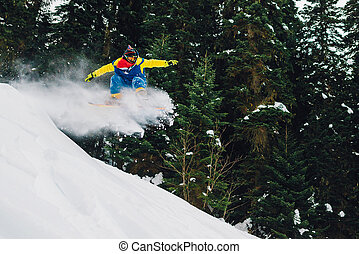 snowboarder is riding fast and jumping in the mountain...