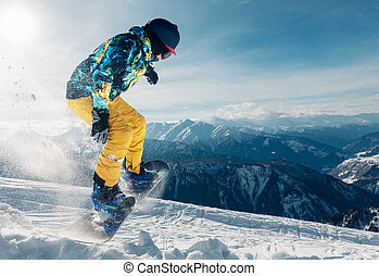 snowboarder is jumping in the sun beam - snowboarder is...
