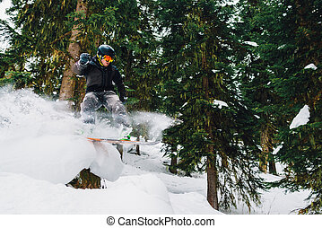 snowboardert is freeriding in the mountain forest -...