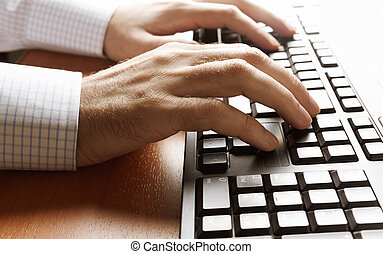 work on computer - hands of businessman on keyboard,...