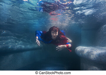 Woman is a mermaid under the water. - Woman is a mermaid...