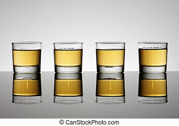 whiskey - Four small shot glasses of whiskey