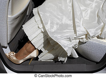 Wedding shoes. The bride in the automobile