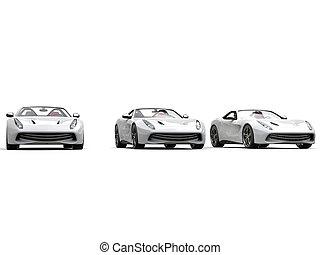 Cool three white sports cars - studio shot