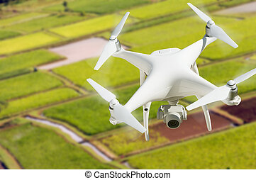 Unmanned Aircraft System (UAV) Quadcopter Drone In The Air...