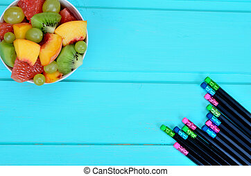 salad fruit with crayon on table
