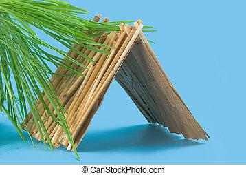 straw hut - Summer straw hut on a blue background