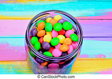 candy in jar on table