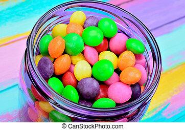 bonbon in jar on table