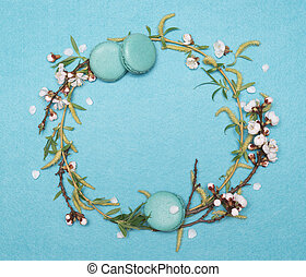 Decorative round frame of plants and sweet pastry