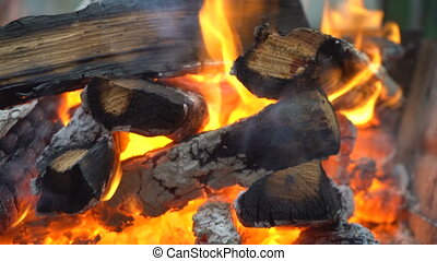 Coals burn in the grill - The red-hot charcoal burns in the...