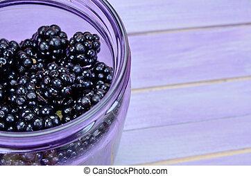 blackberry in jar on table