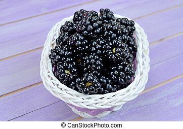 blackberry in basket on table