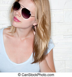 portrait of stylish casual girl with sunglasses