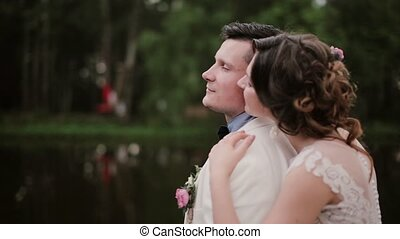 Lovers share intimate moment. Young woman hugs her man...