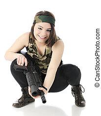 Squatting in Camo with Gun