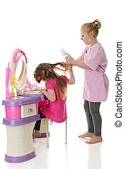 Ouch! - Two sisters playing Beauty Salon. The younger one...