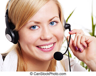 closeup of smiling blond woman with headphone in office