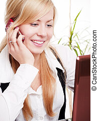 woman in office calling by phone - smiling young woman in...