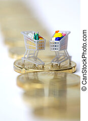 Miniature shopping carts on Euro coins