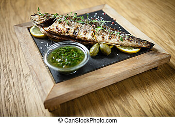 Fresh sea bass. Mediterranean fish, baked entirely in a coal...