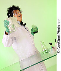 """Eureka! - A young """"mad scientist"""" happily displaying two..."""