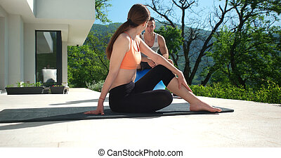 Couple Doing Stretching Exercises Together in front of...