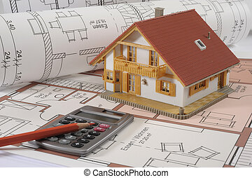 house building blueprint with financial calculator and red...
