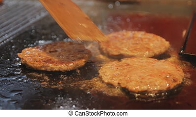Delicious burger patty flipped on hot pan. Cooking meat for...